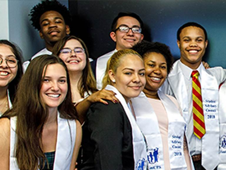 Eight students wearing sashes that say Student Advisory Council 2018