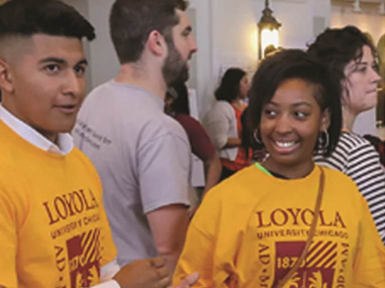 Two smiling students wearing LOYOLA shirts