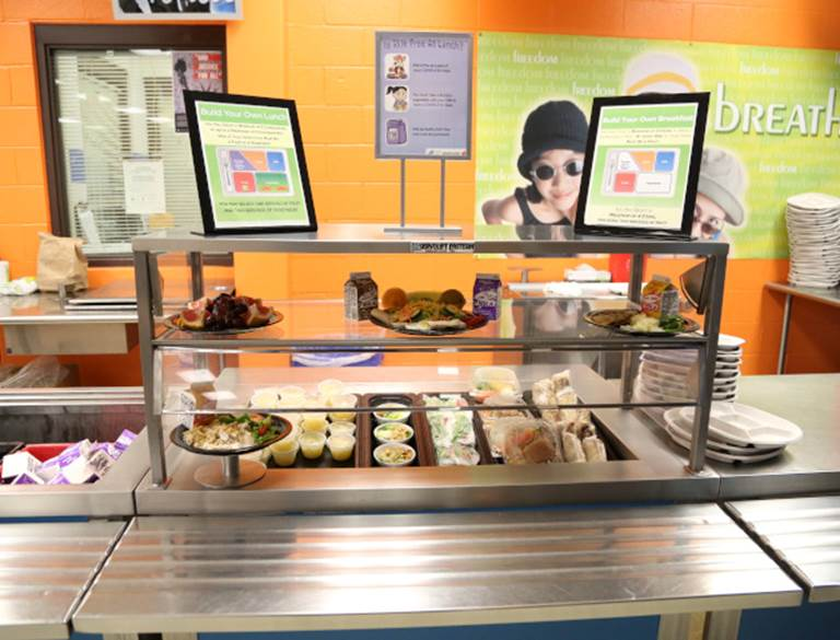 View of a cafeteria serving line with various foods