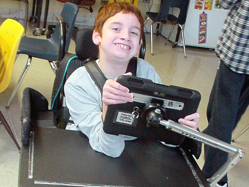 Student using an Augmentative/Alternative Communication (AAC) device.