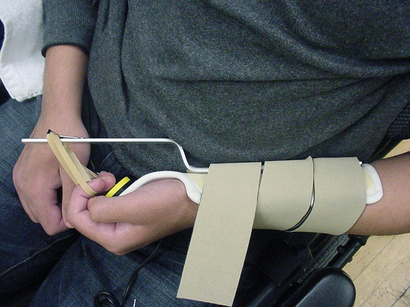 Student using a splint for accessing a switch.